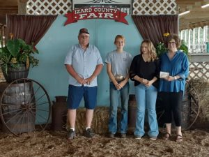 2021 Moss/Gallegos Scholarship Recipients Gracie Wallgren-Crider and Emmarie Savell, pictured with Greg and Rhonda Moss
